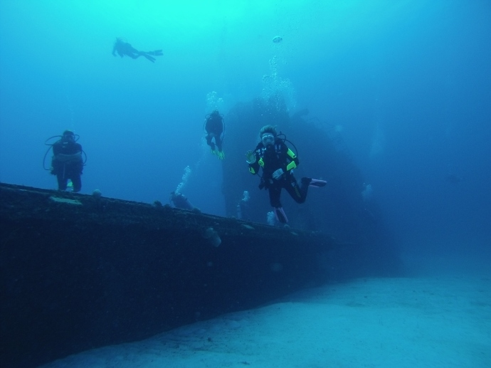 Divers exploring the Aguila wreck.