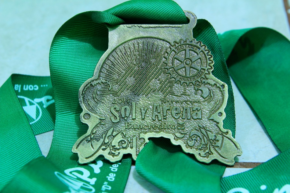 Sol y Arena 10km finisher's medal.