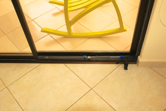 A great secondary use for the trekking poles I brought. The patio door locks are not the most secure.