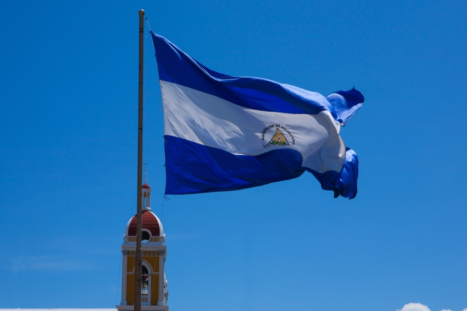 National flag flaying by the Granada Cathedral.