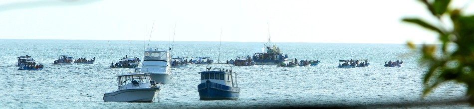 Near the end of the parade after they had moved the Virgin to a fishing vessel.