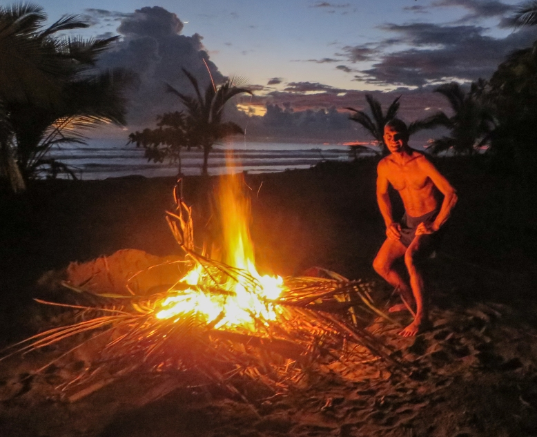 A little fire on the beach to get rid of dead palm fronds, bamboo leaves, and coconuts.
