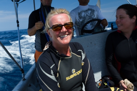 Karen all smiles as we head for another dive site.