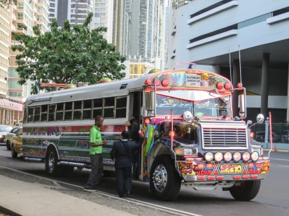 One of the many private transit buses that compete with the municipal service for the business of the locals.