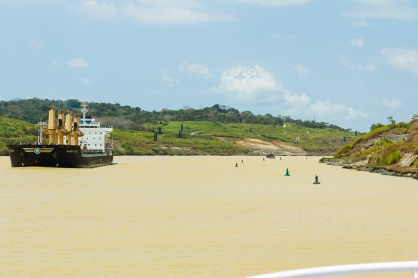 Passing other ships in the Canal. Buoys on the left mark where landslides have made the water too shallow.