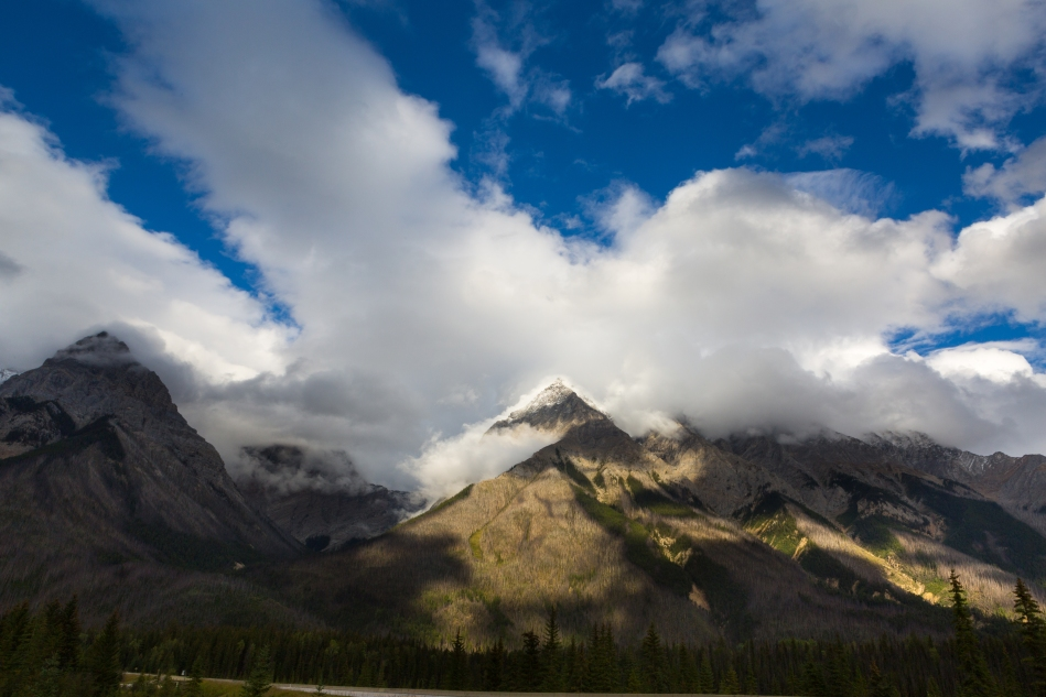 The sun poked through the clouds after we got onto Hwy 1 in Yoho National Park. Chancellor Peak appeared to be glowing.