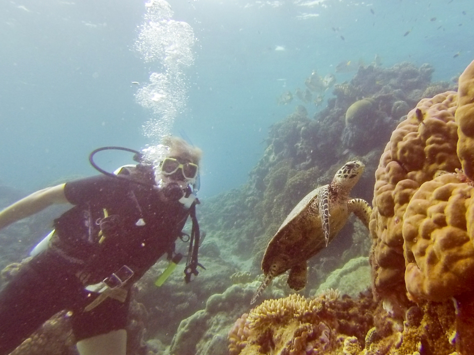 Karen posing with her favourite underwater creature, the Hawksbill Turtle.