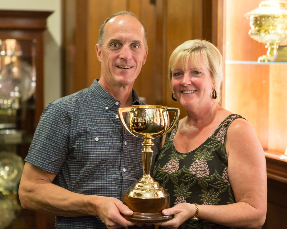 Posing with the original Melbourne Cup.