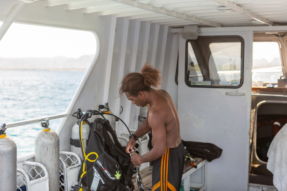 Dive Master Setting Up Gear